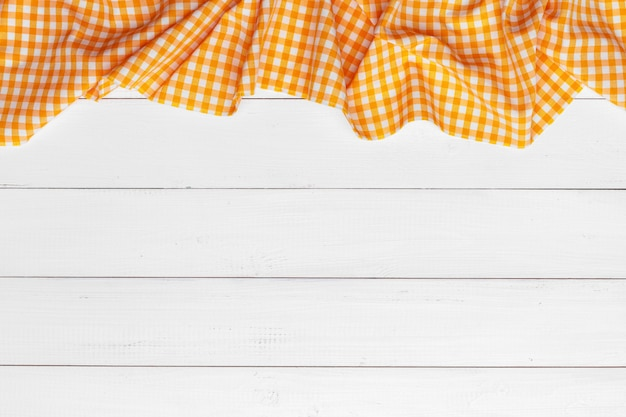 Checkered tablecloth on wooden surface table