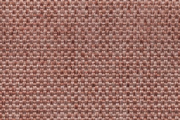 Предпосылка ткани брайна с checkered дизайном, крупным планом.