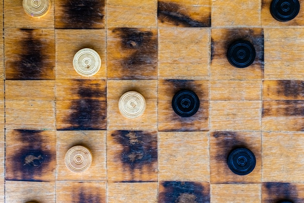 Checkers game pieces, team concepts, strategy and success.
