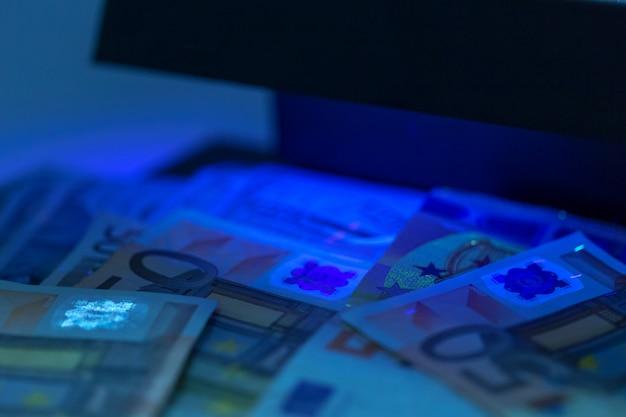 Checking money close up