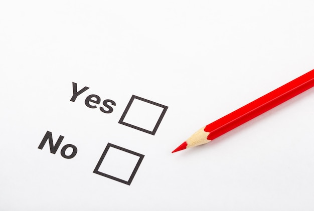 Checklist box with a pencil and word yes and no on white paper
