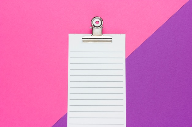 Checklist on a pink and purple background. top view. empty blank