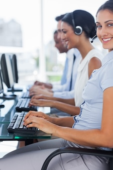 Cheerful agent working on call centre