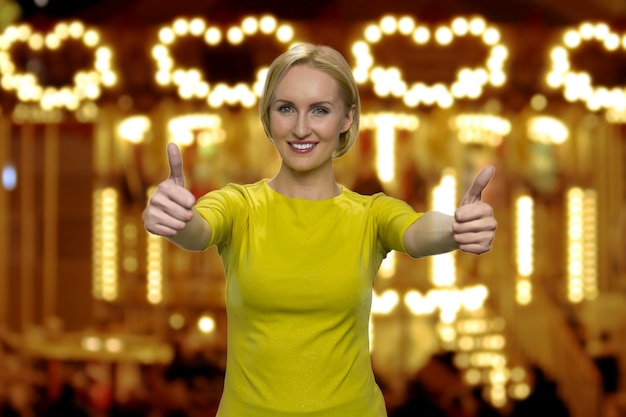 Cheerful american woman is showing thumbs up