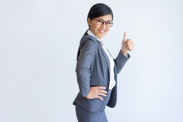 Cheerful asian business lady recommending product