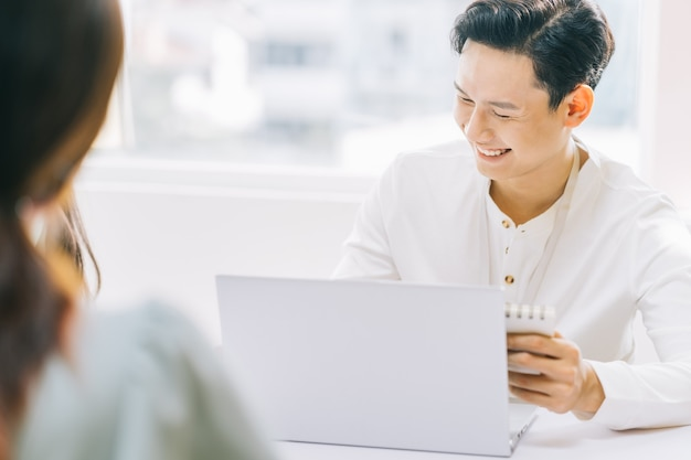 Cheerful asian businessman discussing during the meeting