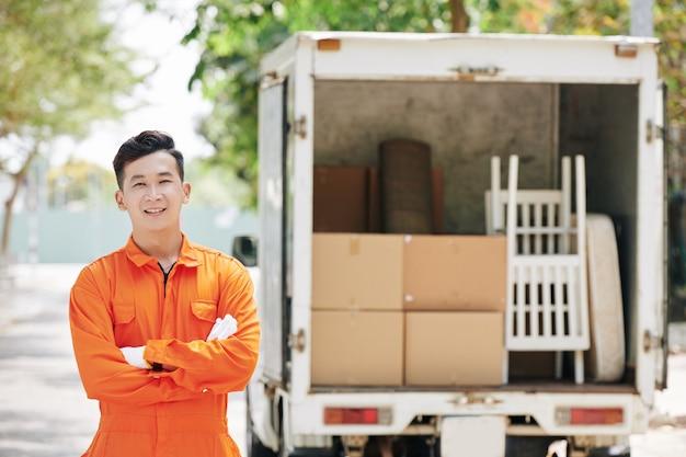 Cheerful asian loader