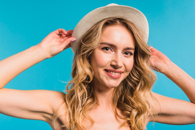 Cheerful attractive young woman in hat