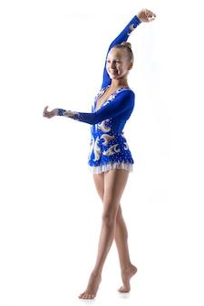 Cheerful ballerina girl dancing