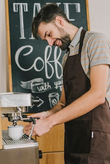 Cheerful barista pouring coffee