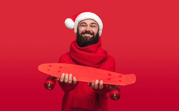 Cheerful bearded guy in santa hat