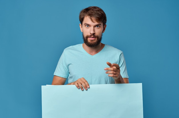 Cheerful bearded man in blue t-shirt mockup poster studio isolated background