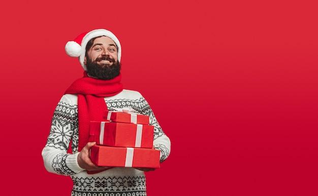 Cheerful bearded man in santa hat