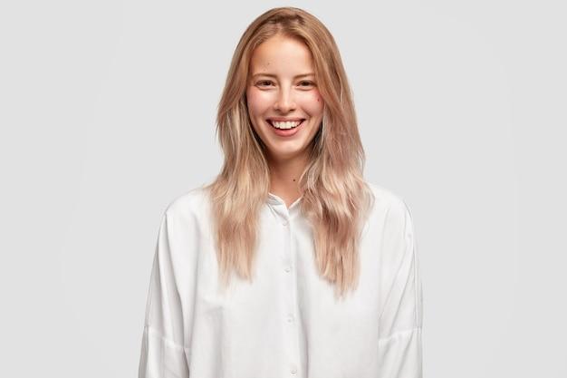 Cheerful beautiful european female with pleasant smile
