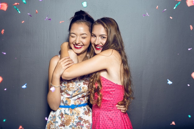 Cheerful beautiful young women having party