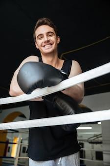 Cheerful boxer looking at camera