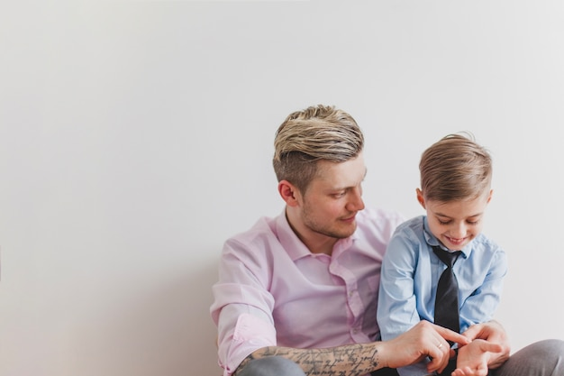 Cheerful boy playing with his father