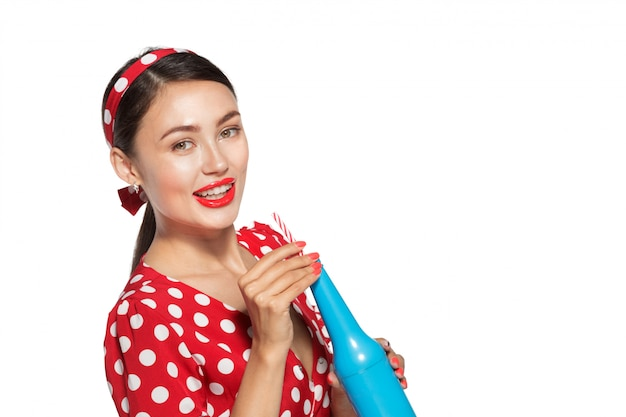 Cheerful brunette pin-up girl holding soft drink
