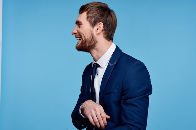 Cheerful business man in a suit gesturing with his hands emotions studio