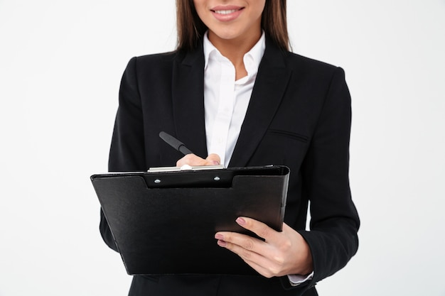 Cheerful business woman holding clipboard.