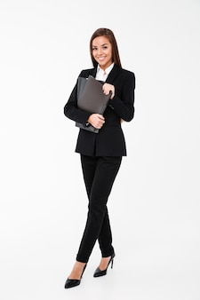 Cheerful business woman holding folders.