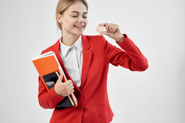Cheerful business woman in a red jacket cryptocurrency documents finance