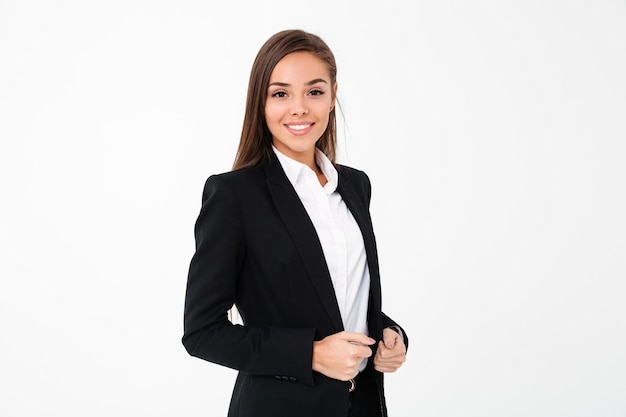 Cheerful business woman standing isolated