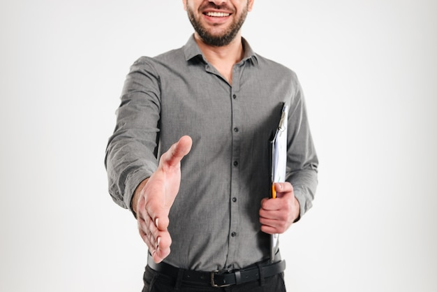 Cheerful businessman give you a hand for handshake.