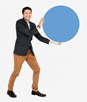 Cheerful businessman holding a blue round board