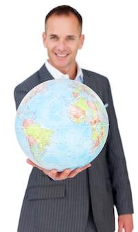 Cheerful businessman holding a terreatrial globe
