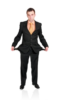 Cheerful businessman show empty pockets. isolated over white