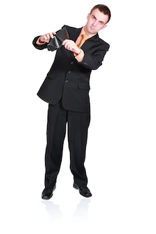 Cheerful businessman show empty wallet. isolated over white