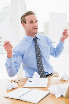 Cheerful businessman showing documents