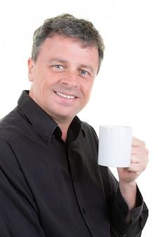 Cheerful businessman with cup of coffee mug tea enjoy with blue eyes