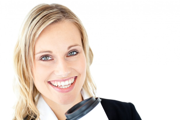 Cheerful businesswoman holding a cup of coffee