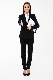 Cheerful businesswoman holding documents and gives you a hand.