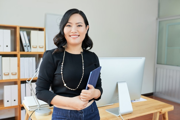 Cheerful businesswoman at office