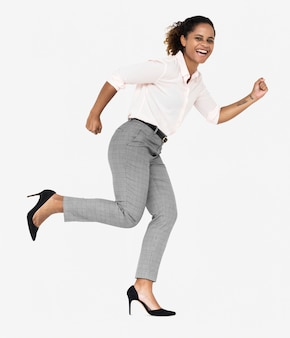 Cheerful businesswoman running towards success