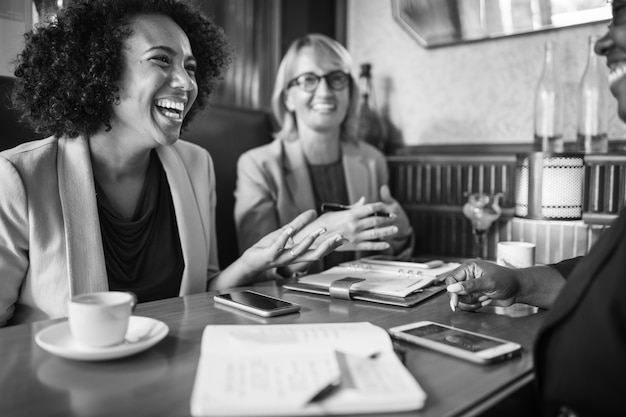 Cheerful businesswomen relaxing at a cafe