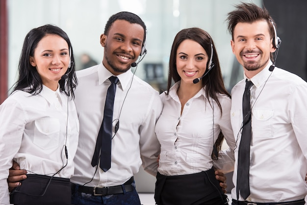 Cheerful call center workers, teamwork