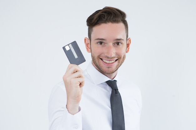 Cheerful cardholder using cashless payment