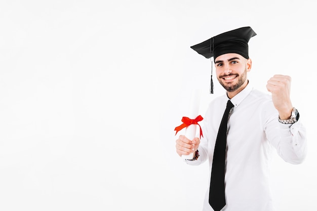 Cheerful celebrating young man with diploma