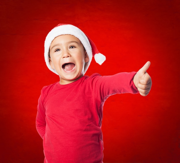 Cheerful child doing a victory gesture