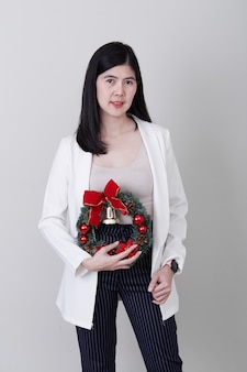 Cheerful christmas young asian woman gesturing