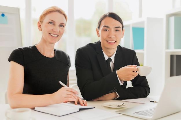Cheerful colleagues having working meeting