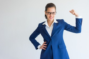 Cheerful confident young businesswoman showing her power.