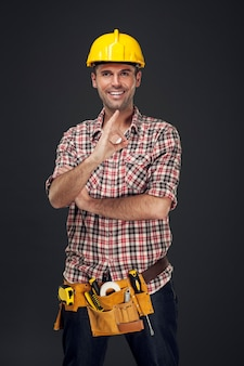 Cheerful construction worker showing ok sign