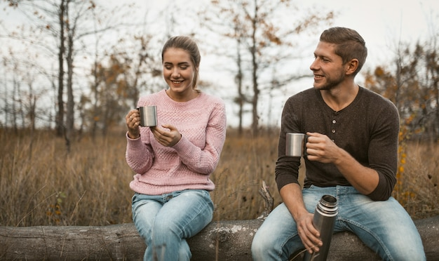 Cheerful couple have picnic in nature