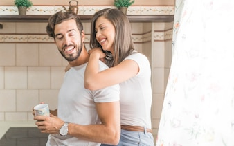 Cheerful couple in kitchen in morning