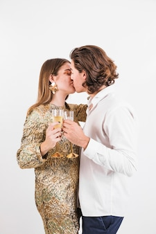 Cheerful couple kissing at birthday party
